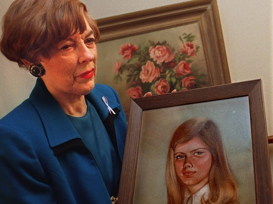 Sue Young of Haslett with a painting of her daughter Martha Sue Young in 1998. Martha was murdered by Donald Miller who was up for parole from prison in the late 1990s. Sue Young died in 2014.
