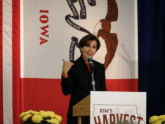 Iowa Gov. Kim Reynolds speaks to supporters during Reynolds' Harvest Festival at the Iowa State Fairgrounds in Des Moines on Saturday, Oct. 21, 2017.