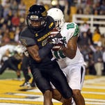 Southern Miss' Cornell Armstrong comes down with an interception against North Texas earlier this season.
