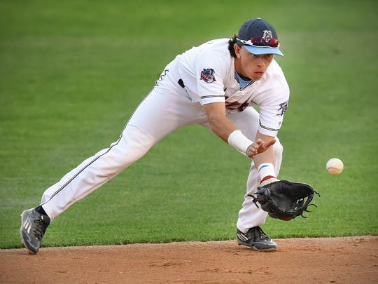 St. Cloud Rox second baseman Angelo Altavilla scoops up a ground ball but can't stop Willmar's Eddie Estrada at first during the second inning Monday, Aug. 15, 2016, at Joe Faber Field.