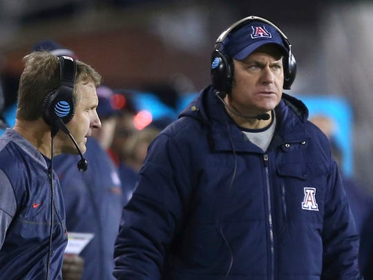 Arizona head coach Rich Rodriguez (right) looks to