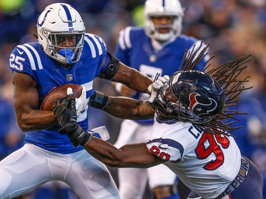 Indianapolis Colts running back Marlon Mack (25) stiff