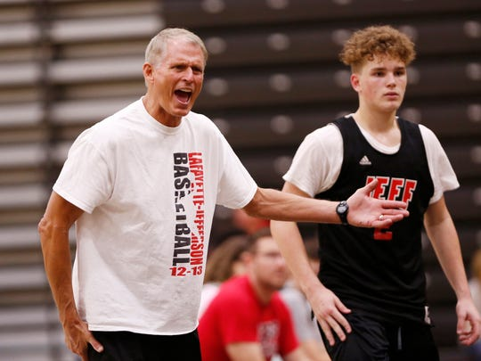 New Lafayette Jeff head coach Mark Barnhizer shouts instructions as the Bronchos take on Kankakee Valley in the Purdue Shootout Thursday, June 14, 2018, at Holloway Gymnasium on the campus of Purdue University.