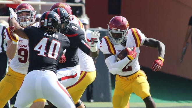 Iowa State Cyclones running back Mike Warren (2) rushes against the Texas Tech Red Raiders in the first half at Jones AT&T Stadium.