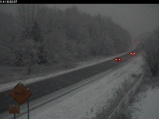 Traffic encounters snow on Interstate 89 late Wednesday afternoon in Bolton, in this VTrans webcam capture.