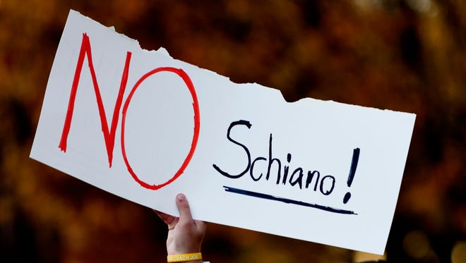 "A fan holds a sign reading ""No Schiano!"" during a gathering of Vols fans reacting to the possible hiring of Ohio State defensive coordinator Greg Schiano as the UT head coach on Nov. 26."