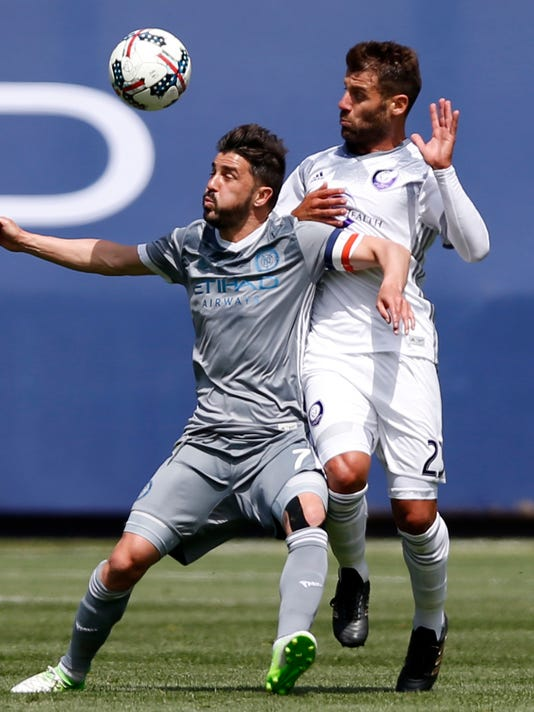 New York City FC forward David Villa (7), of Spain, and Orlando City SC midfielder Antonio Nocerino (23), of Italy, vie for the ball during the first half of an MLS soccer game, Sunday, April 23, 2017, in New York. (AP Photo/Kathy Willens)