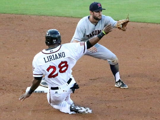 Rudy GutierrezÑEl Paso Times baserunner Rymer Liriano, 28, of the El Paso Chihuahuas slides into second base a moment too late as Tacoma short stop Chris Taylor catches the throw from the outfield Friday night at Southwest University Park.