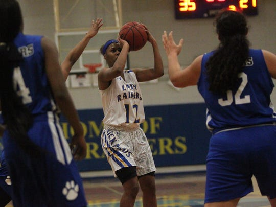 RIckards' Tamia Riles takes a shot against Godby.