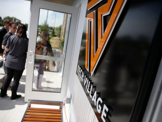 Resident assistants walk into Tech Village, the new student housing option available for those attending Fox Valley Technical College, after a ribbon cutting ceremony Monday in Grand Chute.