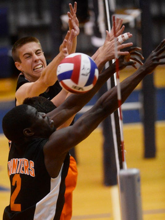 """From top Central York's Landon Shorts, Hayden Wagner, and Jeremiah Dadeboe can't block Penn Manor's hit during the District 3 Class AAA boys' volleyball championship game at Dallastown Area High School Friday, May 22, 2015.  Kate Penn â """" Daily Record/Sunday News"""
