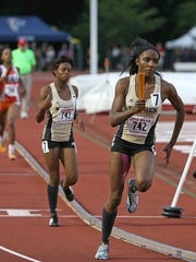 From left, Warren Central's Mikeisha Covington slows