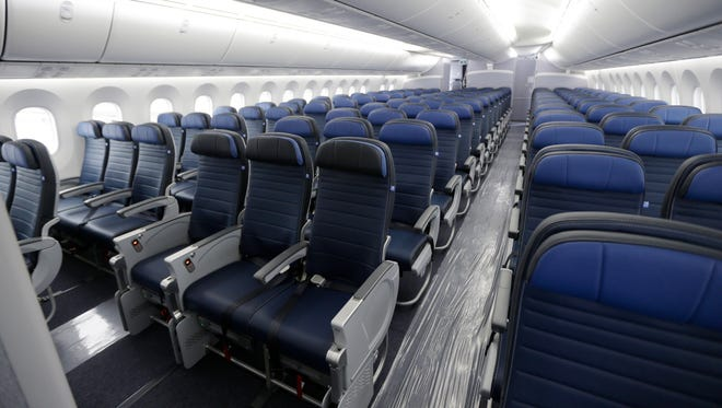Economy class seating is shown on a 2016 United Airlines Boeing 787-9 undergoing final configuration and maintenance work at Seattle-Tacoma International Airport in Seattle.