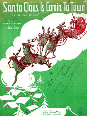 """An autographed copy of Haven Gillespie's hit, """"Santa Claus is coming to town."""""""
