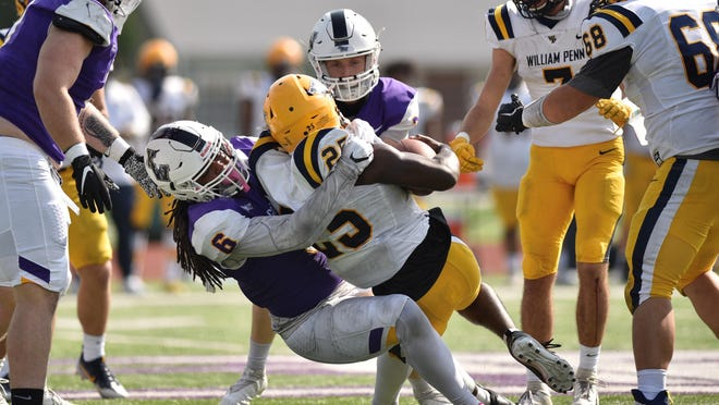 Kansas Wesleyan linebacker Zyair Velazquez brings down William Penn running back Chauncey Andrews during a game at Graves Family Sports Complex in 2020.