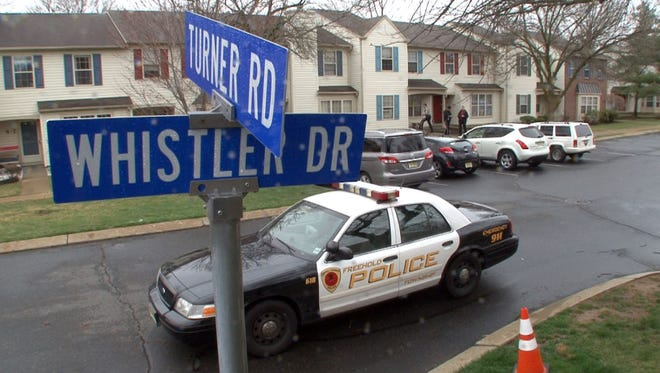 Police investigate a reported drive-by shooting on Whistler Drive in Freehold Township, Thursday morning, April 9, 2015.  DRIVEBYSHOOT0409A    FREEHOLD TOWNSHIP, NJ     STAFF PHOTO BY THOMAS P. COSTELLO