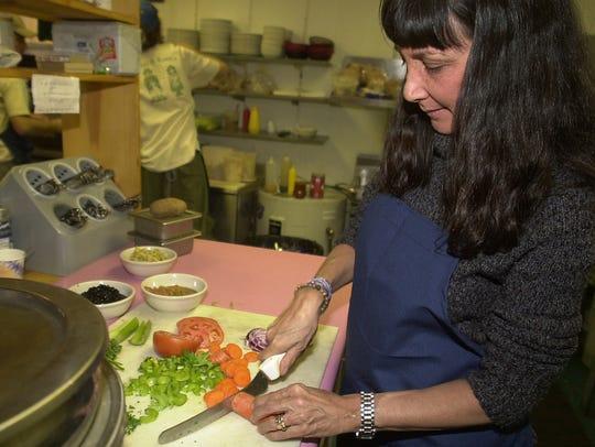 Rosie Beeby preparing black bean soup at Max & Rosie's