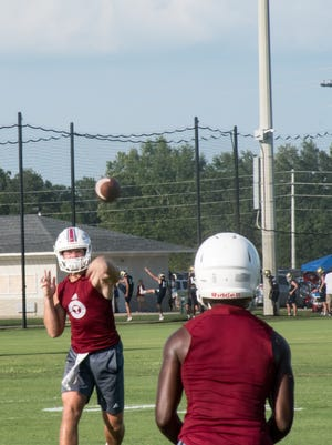 Tate quarterback Hunter Riggan hits an open receiver during the Foley 7-on-7 Showdown on Friday.