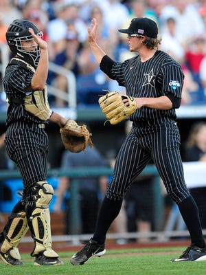 Vanderbilt pitcher Carson Fulmer, right, gets a high-five from catcher Karl Ellison against Virginia during the first inning.