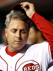Reds manager Bryan Price scratches his head in the