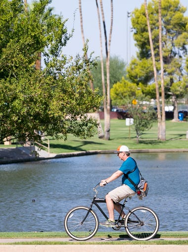 A bicyclist on the Indian Bend Wash Path at Eldorado Park in Scottsdale on Monday, August 17, 2015.