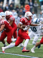 Morris Hills running back Sam Valerio follows his blocker