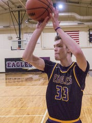 Eyeing the rim during a recent Plymouth Christian Academy