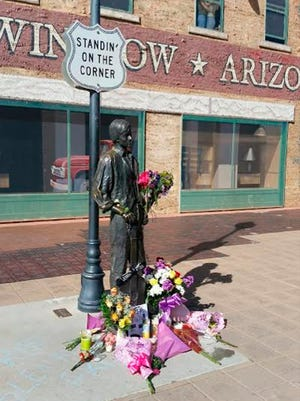 Fans are leaving flowers, hand-written notes and candles at the corner statue in Winslow to celebrate the life of Eagles band member Glenn Frey, who died Monday, Jan. 18.
