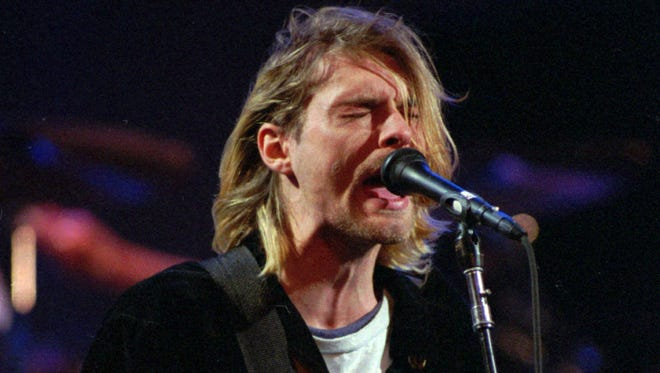 Cobain is seen here performing in Seattle in December 1993, about four months before he shocked the world with his suicide.