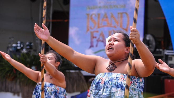 Members of Guma Taotao Lagu, and representing Vincente Benavente Middle School, perform during the 28th Annual Guam Micronesia Island Fair at the Gov. Joseph Flores Memorial Park in Tumon on June 12.