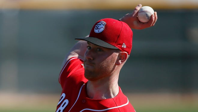 Cincinnati Reds starting pitcher Anthony DeSclafani (28) throws live battling practice at the Cincinnati Reds Player Development Complex in Goodyear, Ariz., on Thursday, Feb. 23, 2017.