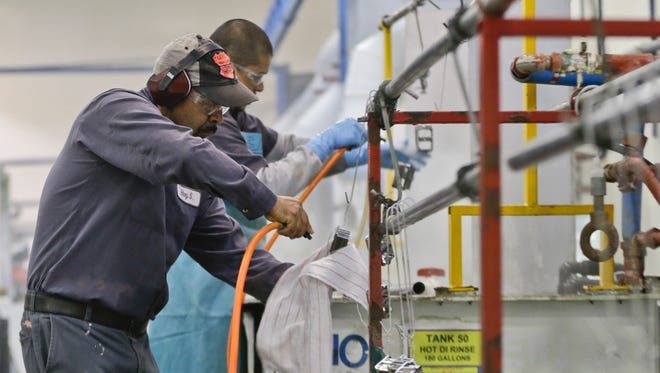 Employees at Sheffield Platers work on the factory floor in San Diego.