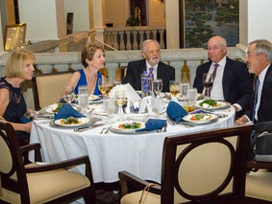 Bonnie Wilson, left, Michael and Linda Levine, Charles