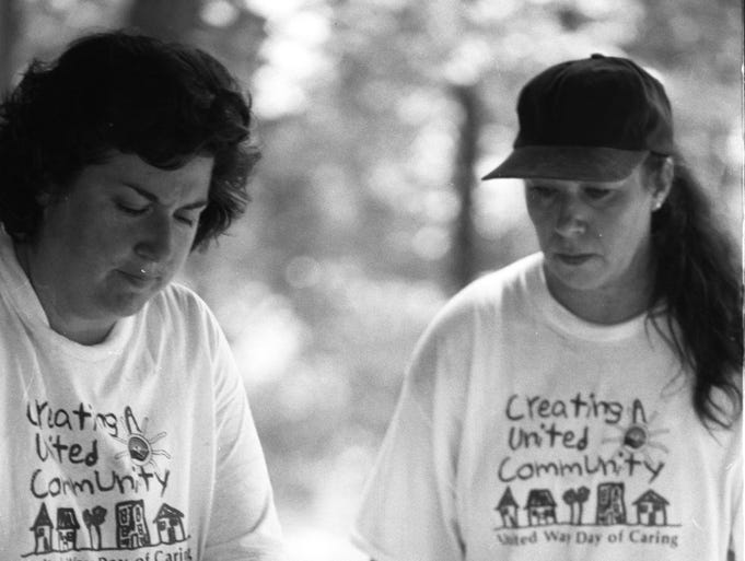 Day of Caring 1996 –Jennifer Jackson, left, CREW director, and Marilyn Hilton work on a construction project at the Girl Scouts' Camp Finbrooke on Thursday. Denise McGill News-Leader