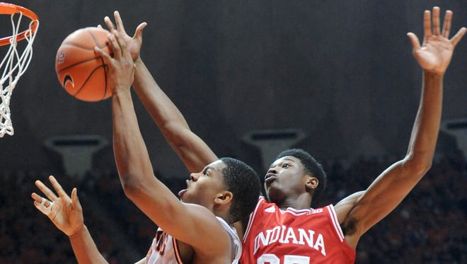 Indiana forward Emmitt Holt (25) guards against Illinois guard Malcolm Hill during an NCAA college basketball game in Champaign, Ill., Sunday, Jan. 18, 2015. Indiana won 80-74.