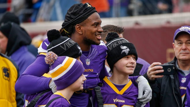 Minnesota Vikings wide receiver Cordarrelle Patterson (84) poses for pictures with fans before the game with the Chicago Bears at TCF Bank Stadium in December.