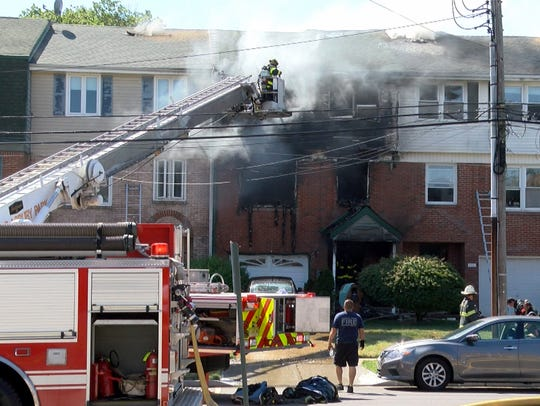 Firefighters work to contain a fire in a Park Avenue