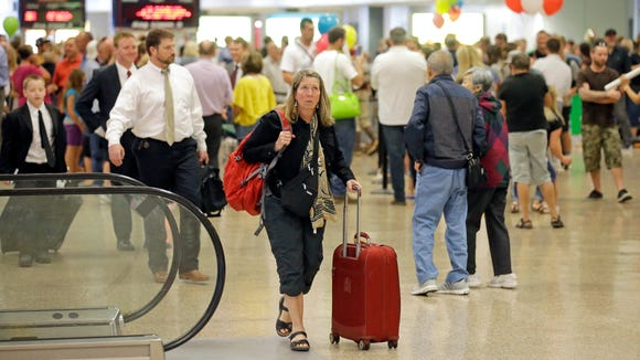People carry their bags after arriving at Salt Lake