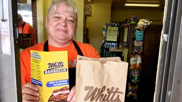 Bargain diners gobble up Whitt's Barbecue anniversary deal