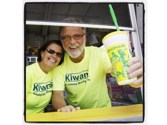 Kiwanis volunteers Denise and Jerry Kwas sold fresh-squeezed lemonade at a recent Livonia Spree.