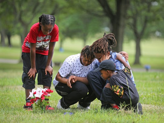 (From left to right:) Samuel DuBose, 10, Teaila Williamston,