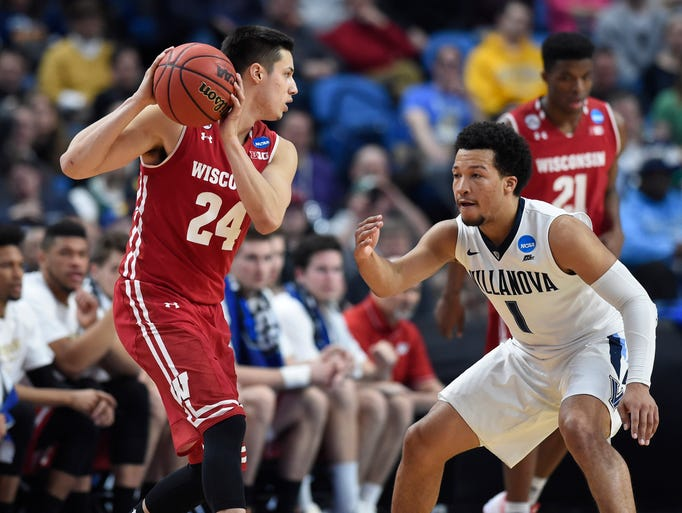 Wisconsin guard Bronson Koenig looks to pass the ball