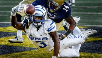University of Memphis receiver Anthony Miller (bottom) can not hang onto a touchdown reception while defended by Navy cornerback Elijah Merchant (top) during second quarter action at Navy-Marine Corps Memorial Stadium in Annapolis, Maryland.