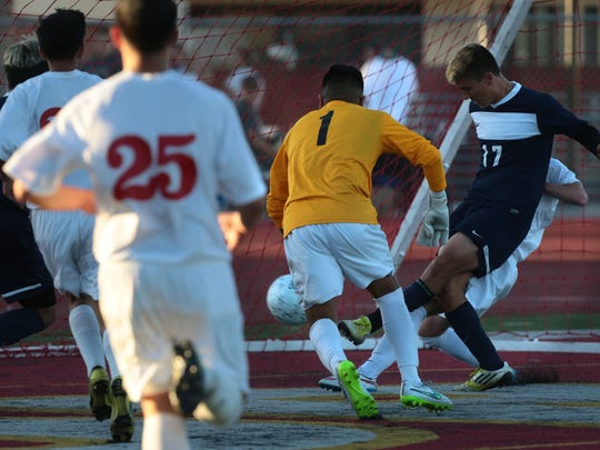 La Quinta's Adam Lopez's goal in the first half ties the game at 2-2 with Santa Ana during the CIF Southern Section Division 2 boys soccer championship game in Corona on Friday. La Quinta won the championship 3-2.