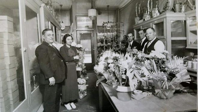 John Perlo (far right) and employees at the original Fioravanti Florist store on North Street.
