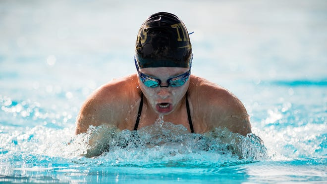 Treasure Coast's McKenna Browning swims the breaststroke during the 200 medley relay during the high school swim and dive double dual meet Wednesday, Oct. 11, 2017, at Indian River State College in Fort Pierce. Fort Pierce Central, St. Lucie West Centennial and Treasure Coast competed against each other, while Vero Beach faced John Carroll Catholic.