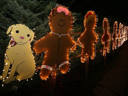 Gingerbread people line the sidewalk as part of one