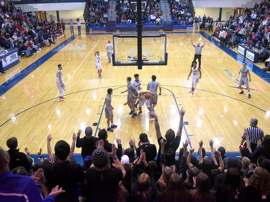 Cedar Crest fans erupt after a three point shot drops through the net during the Lancaster-Lebanon League Championship game. The Falcons lost to McCaskey 54-47 at Manheim Township High School Thursday evening, Feb. 11.