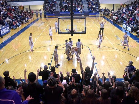 Cedar Crest fans erupt after a three point shot drops
