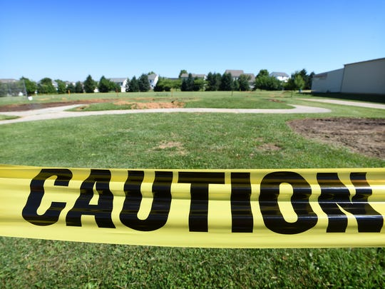 Caution tape surrounds an area that once was a playground in Campbelltown. Most of the park's playground equipment has been moved to prepare for the construction of a new South Londonderry Township municipal building.